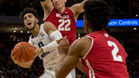 <p>               Marquette guard Markus Howard, left, is defended by Wisconsin during the first half of an NCAA college basketball game Saturday, Dec. 8, 2018, in Milwaukee. (AP Photo/Darren Hauck)             </p>