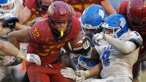 <p>               Iowa State running back David Montgomery (32) breaks a tackle by Drake defensive back Alex Rogers (9) during the second half of an NCAA college football game, Saturday, Dec. 1, 2018, in Ames, Iowa. Iowa State won 27-24. (AP Photo/Charlie Neibergall)             </p>