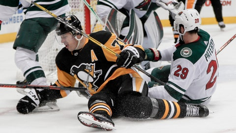 <p>               Pittsburgh Penguins' Evgeni Malkin (71) and Minnesota Wild's Greg Pateryn (29) hit the ice during the second period of an NHL hockey game Thursday, Dec. 20, 2018, in Pittsburgh. (AP Photo/Keith Srakocic)             </p>