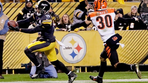 <p>               Pittsburgh Steelers wide receiver JuJu Smith-Schuster (19) heads to the end zone for a touchdown past Cincinnati Bengals free safety Jessie Bates (30) in the third quarter of an NFL football game, Sunday, Dec. 30, 2018, in Pittsburgh. (AP Photo/Gene J. Puskar)             </p>
