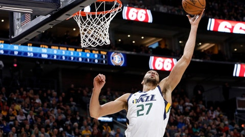 <p>               Utah Jazz's Rudy Gobert rebounds the ball in the first half of an NBA basketball game against the New York Knicks on Saturday, Dec. 29, 2018, in Salt Lake City. (AP Photo/Kim Raff)             </p>