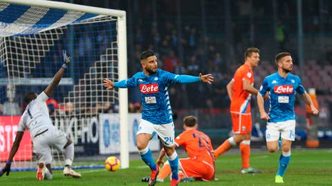<p>               Napoli's Lorenzo Insigne, center, celebrates after scoring during the Italian Serie A soccer match between Napoli and SPAL at the San Paolo stadium in Naples, Italy, Saturday, Dec. 22, 2018. (Cesare Abbate/ANSA via AP)             </p>