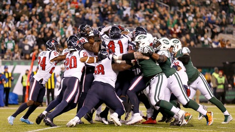 <p>               A scrum is formed on the goalie as New York Jets running back Elijah McGuire (25) scores a touchdown run against the Houston Texans during the second half of an NFL football game, Saturday, Dec. 15, 2018, in East Rutherford, N.J. (AP Photo/Adam Hunger)             </p>