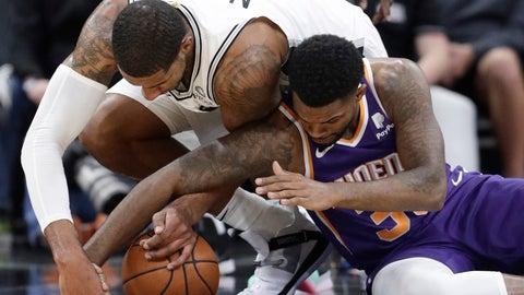 <p>               San Antonio Spurs forward LaMarcus Aldridge (12) and Phoenix Suns guard Troy Daniels (30) scramble for a loose ball during the first half of an NBA basketball game, Tuesday, Dec. 11, 2018, in San Antonio. (AP Photo/Eric Gay)             </p>