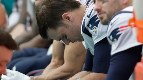 <p>               New England Patriots quarterback Tom Brady (12), center, looks down while on the sidelines, during the second half of an NFL football game , Sunday, Dec. 9, 2018, in Miami Gardens, Fla. The Dolphins defeated the Patriots 34-33. (AP Photo/Lynne Sladky)             </p>