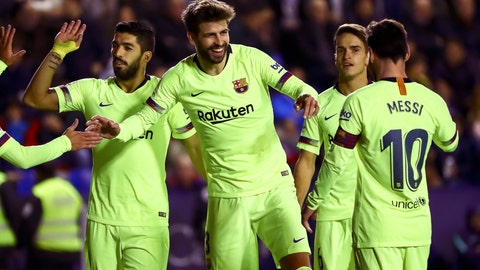 <p>               FC Barcelona's defender Gerard Pique, center, celebrate after scoring the 0-5, goal with his teammate FC Barcelona's forward Luis Suarez, left, and FC Barcelona's forward Lionel Messi, right, their La Liga soccer match between Levante UD and FC Barcelona at Ciutat de Valencia stadium in Valencia, Spain, Sunday, Dec. 16, 2018.(AP Photo/Jose Miguel Fernandez de Velasco)             </p>