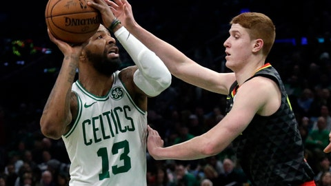 <p>               Boston Celtics forward Marcus Morris (13) goes up to shoot against Atlanta Hawks guard Kevin Huerter in the second quarter of an NBA basketball game, Friday, Dec. 14, 2018, in Boston. (AP Photo/Elise Amendola)             </p>