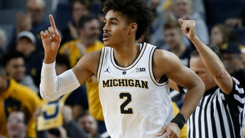 <p>               Michigan guard Jordan Poole reacts to hitting a basket against South Carolina in the first half of an NCAA college basketball game in Ann Arbor, Mich., Saturday, Dec. 8, 2018. (AP Photo/Paul Sancya)             </p>
