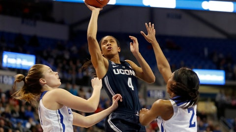 <p>               Connecticut's Mikayla Coombs (4) heads to the basket past Saint Louis' Chloe Rice, left, and Ciaja Harbison (2) during the second half of an NCAA college basketball game Tuesday, Dec. 4, 2018, in St. Louis. Connecticut won 98-42. (AP Photo/Jeff Roberson)             </p>