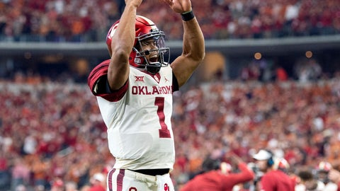 <p>               Oklahoma quarterback Kyler Murray (1) celebrates after throwing a touchdown pass to tight end Grant Calcaterra at the end of the first half of the Big 12 Conference championship NCAA college football game against Texas on Saturday, Dec. 1, 2018, in Arlington, Texas. (AP Photo/Jeffrey McWhorter)             </p>