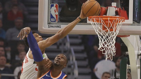<p>               Milwaukee Bucks' Giannis Antetokounmpo, left, tries to dunk over New York Knicks' Noah Vonieh during the first half of an NBA basketball game Thursday, Dec. 27, 2018, in Milwaukee. (AP Photo/Jeffrey Phelps)             </p>