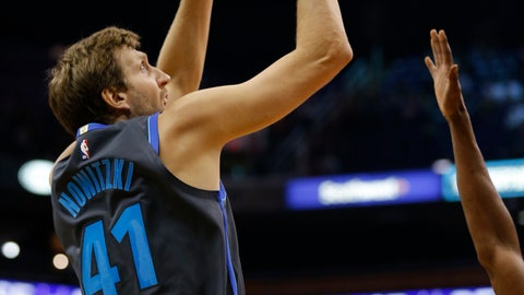<p>               Dallas Mavericks forward Dirk Nowitzki scores against the Phoenix Suns in the first half during an NBA basketball game, Thursday, Dec. 13, 2018, in Phoenix. (AP Photo/Rick Scuteri)             </p>