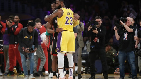 <p>               Los Angeles Lakers forward LeBron James (23) hugs ex teammate and current Miami Heat player Dwyane Wade during the first half of an NBA basketball game Monday, Dec. 10, 2018, in Los Angeles. (AP Photo/Marcio Jose Sanchez)             </p>