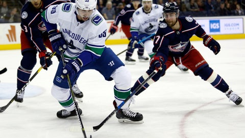 <p>               Vancouver Canucks forward Tim Schaller, center, chases the puck between Columbus Blue Jackets defenseman Seth Jones, left, and forward Brandon Dubinsky during the first period of an NHL hockey game in Columbus, Ohio, Tuesday, Dec. 11, 2018. (AP Photo/Paul Vernon)             </p>