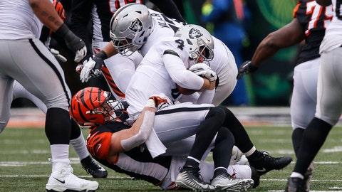 <p>               Oakland Raiders quarterback Derek Carr (4) is sacked by Cincinnati Bengals defensive end Sam Hubbard in the first half of an NFL football game, Sunday, Dec. 16, 2018, in Cincinnati. (AP Photo/Gary Landers)             </p>