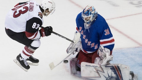 <p>               New York Rangers goaltender Henrik Lundqvist (30) makes a save against Arizona Coyotes right wing Conor Garland (83) during overtime of an NHL hockey game, Friday, Dec. 14, 2018, at Madison Square Garden in New York. (AP Photo/Mary Altaffer)             </p>