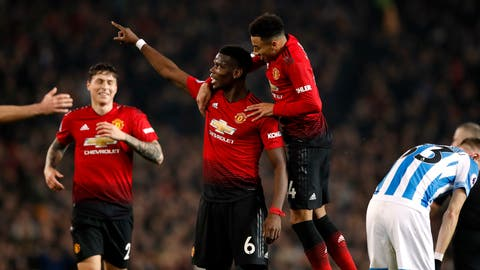 <p>               Manchester United's Paul Pogba, center, celebrates scoring against Huddersfield during the English Premier League soccer match  at Old Trafford, Manchester, England, Wednesday Dec. 26, 2018. (Martin Rickett/PA via AP)             </p>