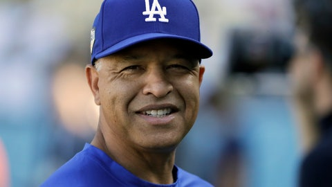 """<p>               FILE - In this Oct. 27, 2018, file photo, Los Angeles Dodgers manager Dave Roberts watches batting practice before Game 4 of the World Series baseball game against the Boston Red Sox, in Los Angeles. The Dodgers have agreed on a four-year contract with manager Dave Roberts, which would keep him at the helm of the team through 2022. """"Keeping Doc as our leader on the field was a top priority this offseason and now that we've accomplished that we are excited to collectively shift all of our focus to doing all we can to bring a World Championship to our passionate fans,"""" Andrew Friedman, the Dodgers president of baseball operations, said in a statement Monday, Dec. 3, 2018. (AP Photo/David J. Phillip, File)             </p>"""