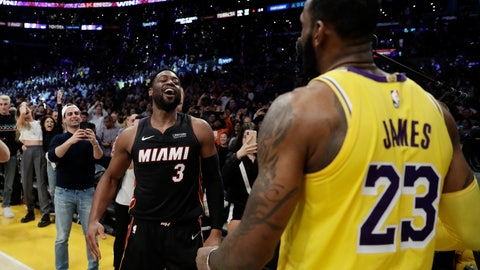 <p>               Miami Heat guard Dwyane Wade, left, smiles at Los Angeles Lakers' LeBron James (23) at the end of an NBA basketball game Monday, Dec. 10, 2018, in Los Angeles. (AP Photo/Marcio Jose Sanchez)             </p>