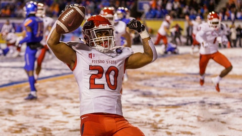 <p>               Fresno State running back Ronnie Rivers (20) celebrates a touchdown in overtime against Boise State during an NCAA college football game for the Mountain West championship Saturday, Dec. 1, 2018, in Boise, Idaho. Fresno State won 19-16. (AP Photo/Steve Conner)             </p>