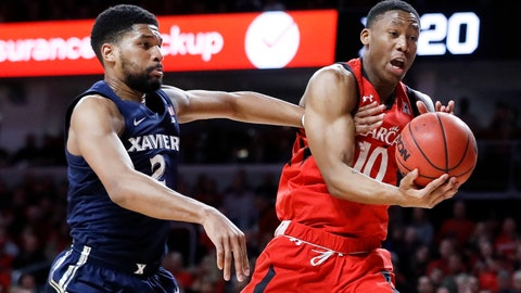 <p>               Cincinnati's Rashawn Fredericks (10) rebounds against Xavier's Kyle Castlin (2) during the first half of an NCAA college basketball game, Saturday, Dec. 8, 2018, in Cincinnati. (AP Photo/John Minchillo)             </p>