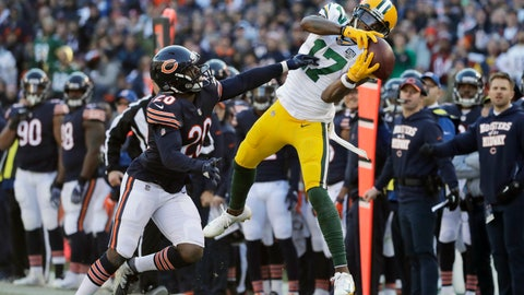 <p>               FILE - In this Sunday, Dec. 16, 2018, file photo Green Bay Packers wide receiver Davante Adams (17) makes a catch against Chicago Bears cornerback Prince Amukamara (20) during the second half of an NFL football game, in Chicago. Adams is within reach of a couple club receiving records over the final two weeks of the season.  (AP Photo/Nam Y. Huh, File)             </p>