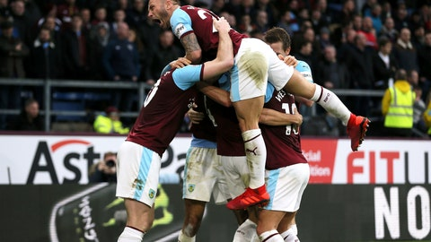 <p>               Burnley's Dwight McNeil, hidden, celebrates scoring his side's second goal of the game against West Ham United during their English Premier League soccer match at Turf Moor in Burnley, England, Sunday Dec. 30, 2018. (Richard Sellers/PA via AP)             </p>
