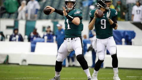 <p>               FILE - In this Sept. 23, 2018, file photo, Philadelphia Eagles quarterback Carson Wentz (11) and quarterback Nick Foles (9) throw before an NFL football game against the Indianapolis Colts, in Philadelphia.  Eagles coach Doug Pederson says Carson Wentz has a stress fracture in his back and is questionable to play Sunday night, Dec. 16 against the Rams in Los Angeles. (AP Photo/Matt Rourke, File)             </p>