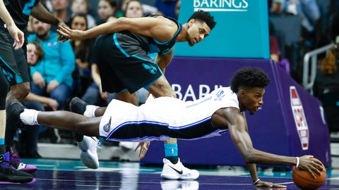 <p>               Orlando Magic forward Jonathan Isaac, right, dives for the ball while being covered by Charlotte Hornets guard Jeremy Lamb in the first half of an NBA basketball game Monday, Dec. 31, 2018, in Charlotte, N.C. (AP Photo/Jason E. Miczek)             </p>