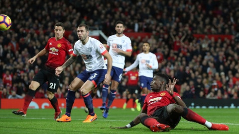 <p>               Manchester United's Paul Pogba, foreground, scores his side's first goal of the game against Bournemouth, during their English Premier League soccer match at Old Trafford in Manchester, England, Sunday Dec. 30, 2018. (Martin Rickett/PA via AP)             </p>