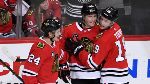 <p>               Chicago Blackhawks defenseman Gustav Forsling, center, celebrates his goal against the Nashville Predators with center Dominik Kahun (24) and center Jonathan Toews (19) during the second period of an NHL hockey game Tuesday, Dec. 18, 2018, in Chicago. (AP Photo/David Banks)             </p>