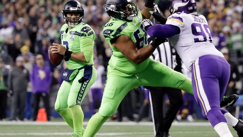 <p>               Seattle Seahawks quarterback Russell Wilson, left, looks for room to pass as Jordan Simmons (66) tries to hold back Minnesota Vikings' Linval Joseph Minnesota Vikings in the first half of an NFL football game, Monday, Dec. 10, 2018, in Seattle. (AP Photo/Ted S. Warren)             </p>