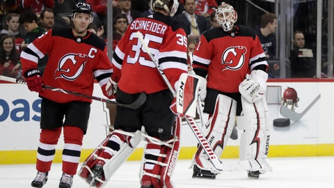 <p>               New Jersey Devils goaltender Keith Kinkaid, right, takes the ice while switching out with goaltender Cory Schneider, center, during the first period of an NHL hockey game, Friday, Dec. 14, 2018, in Newark. Schneider gave up three goals in the first period before being pulled. (AP Photo/Julio Cortez)             </p>