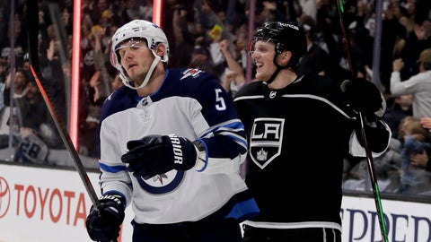 <p>               Los Angeles Kings left wing Austin Wagner, right, celebrates after scoring as Winnipeg Jets defenseman Dmitry Kulikov reacts during the second period of an NHL hockey game in Los Angeles, Tuesday, Dec. 18, 2018. (AP Photo/Chris Carlson)             </p>