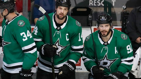 <p>               Dallas Stars left wing Jamie Benn (14) and center Tyler Seguin (91) look on from the bench during the second period of an NHL hockey game against the Detroit Red Wings in Dallas, Saturday, Dec. 29, 2018. (AP Photo/LM Otero)             </p>