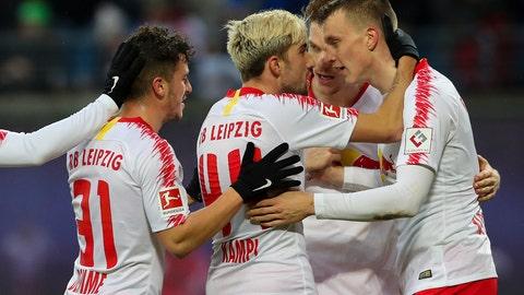 <p>               Leipzig's scorer Lukas Klostermann, right, and his teammates celebrate the opening goal during the German Bundesliga soccer match between RB Leipzig and SV Werder Bremen in Leipzig, Germany, Saturday, Dec. 22, 2018. (Jan Woitas/dpa via AP)             </p>