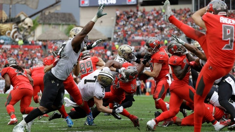 <p>               FILE - In this Sunday, Dec. 9, 2018 file photo, New Orleans Saints Taysom Hill (7) blocks a punt by Tampa Bay Buccaneers' Bryan Anger during the second half of an NFL football game in Tampa, Fla. Saints third-string quarterback Taysom Hill is piling up highlights that have nothing to do with throwing the ball the latest being his momentum-changing blocked punt. The ultimate utility player has made an already good New Orleans team that much more of a contender. (AP Photo/Mark LoMoglio, File)             </p>