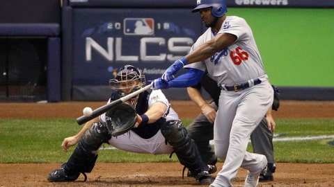 <p>               FILE - In this Oct. 20, 2018, file photo, Los Angeles Dodgers' Yasiel Puig (66) hits a three -run home run during the sixth inning of Game 7 of the National League Championship Series baseball game against the Milwaukee Brewers in Milwaukee. The Dodgers shook up their National League-championship roster Friday, Dec. 21, 2018, trading Puig, Matt Kemp and left-hander Alex Wood and cash to the Cincinnati Reds for right-hander Homer Bailey. (AP Photo/Charlie Riedel, File)             </p>