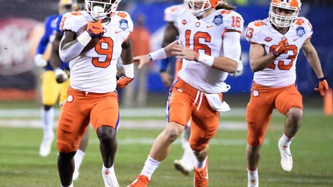 <p>               FILE - In this Saturday, Dec. 1, 2018, file photo, Clemson's Travis Etienne (9) followed by quarterback Trevor Lawrence (16) runs for a touchdown against Pittsburgh in the first half of the Atlantic Coast Conference championship NCAA college football game in Charlotte, N.C. Clemson's high-octane offense is led by the pair of young, talented offensive players. (AP Photo/Mike McCarn, File)             </p>