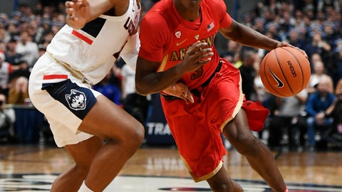 <p>               Connecticut's Jalen Adams (4) guards Arizona's Dylan Smith (3) during the first half of an NCAA college basketball game, Sunday, Dec. 2, 2018, in Hartford, Conn. (AP Photo/Jessica Hill)             </p>