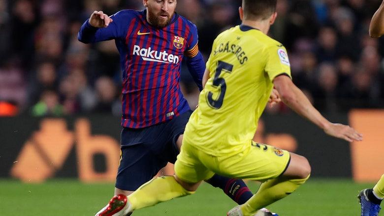 Barcelona puts pressure on Sevilla by beating Villarreal 2-0