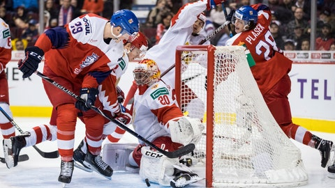 <p>               Russia goalie Pyotr Kochetkov (20) stops Czech Republic's Jachym Kondelik (29) during third-period IIHF world junior hockey championship game action in Vancouver, British Columbia, Friday, Dec. 28, 2018. (Darryl Dyck/The Canadian Press via AP)             </p>