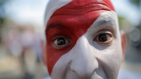 <p>               In this Saturday, Nov. 24, 2018 photo, a River Plate soccer fan poses for a photo prior the final soccer match of the Copa Libertadores between River Plate and Boca Juniors in Buenos Aires, Argentina. The final match of the Copa Libertadores has been pushed back after the bus carrying the Boca Juniors players was attacked by fans as it drove to the Antonio Vespucio Liberti stadium. (AP Photo/Sebastian Pani)             </p>