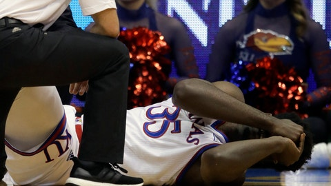<p>               Kansas center Udoka Azubuike (35) is aided by training staff after an injury during the first half of an NCAA college basketball game against Wofford in Lawrence, Kan., Tuesday, Dec. 4, 2018. (AP Photo/Orlin Wagner)             </p>