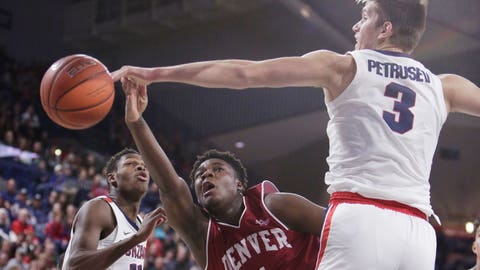 <p>               Gonzaga forward Filip Petrusev (3) blocks a shot by Denver forward David Nzekwesi (1) during the second half of an NCAA college basketball game in Spokane, Wash., Friday, Dec. 21, 2018. (AP Photo/Young Kwak)             </p>