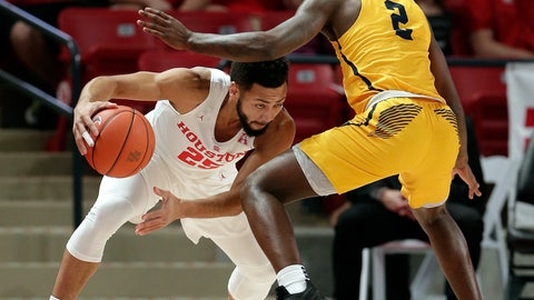 <p>               Houston guard Galen Robinson Jr. (25) looks to drive around Coppin State guard Taqwain Drummond (2) during the first half of an NCAA college basketball game Sunday, Dec. 23, 2018, in Houston. (AP Photo/Michael Wyke)             </p>