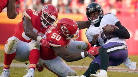 <p>               Kansas City Chiefs linebackers Justin Houston (50) and Reggie Ragland (59) sack Baltimore Ravens quarterback Lamar Jackson (8) during the second half of an NFL football game in Kansas City, Mo., Sunday, Dec. 9, 2018. (AP Photo/Ed Zurga)             </p>