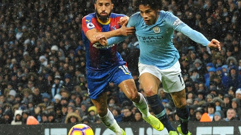 <p>               Crystal Palace's Andros Townsend, left, and Manchester City's Leroy Sane challenge for the ball during the English Premier League soccer match between Manchester City and Crystal Palace at Etihad stadium in Manchester, England, Saturday, Dec. 22, 2018. (AP Photo/Rui Vieira)             </p>