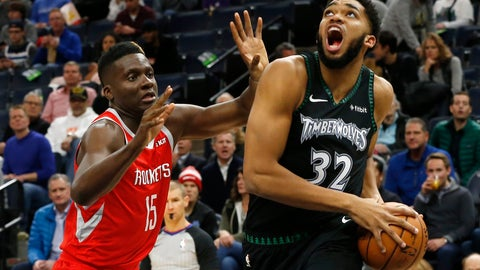 <p>               Minnesota Timberwolves' Karl-Anthony Towns, right, eyes the basket as Houston Rockets' Clint Capela of Switzerland defends in the first half of an NBA basketball game Monday, Dec. 3, 2018, in Minneapolis. (AP Photo/Jim Mone)             </p>