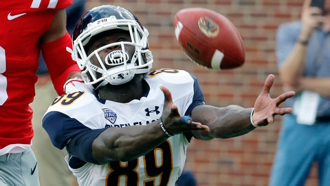 <p>               FILE - In this Sept. 22, 2018, file photo, Kent State wide receiver Antwan Dixon (89) dives but cannot make the catch during the first half of an NCAA college football game against Mississippi, in Oxford, Miss. Kent State receiver Antwan Dixon, Dartmouth defensive lineman Seth Simmer and Carson-Newman running back Antonio Wimbush are the first recipients of the Mayo Clinic college football Comeback Player of the Year Award. The new award recognizes college football players from FBS, FCS and lower divisions who overcome injury, illness or other challenges to return to the field. (AP Photo/Rogelio V. Solis, File)             </p>